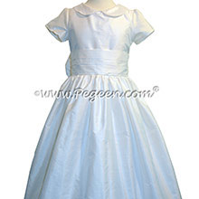 Antique White silk First Communion style dresses trimmed with pearls and rhinestones