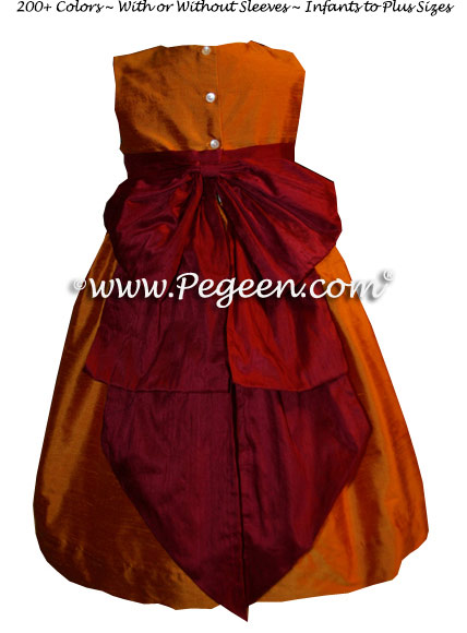 Deep cranberry and pumpkin Flower Girl dresses by PEGEEN Style 345