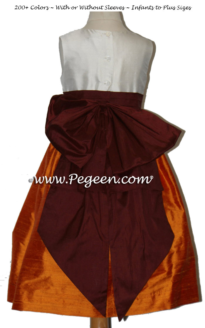 Flower girl dresses in Burgundy red and Mango Orange silk | Pegeen