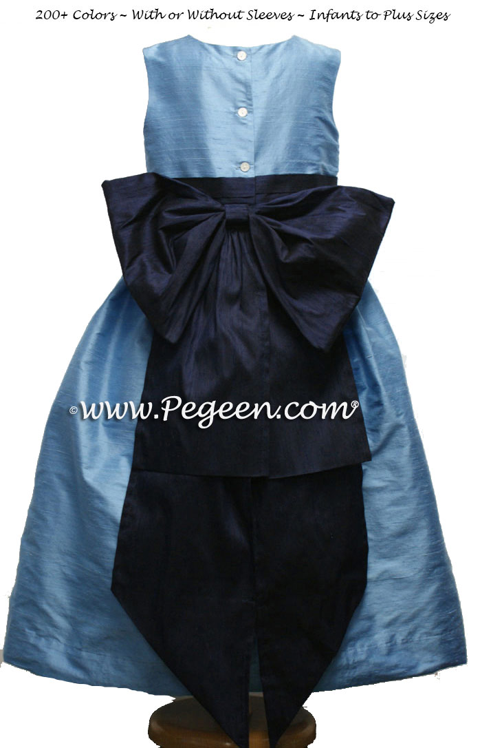 MEDIUM BLUE AND NAVY FLOWER GIRL DRESSES IN SILK WITH BACK BUSTLE