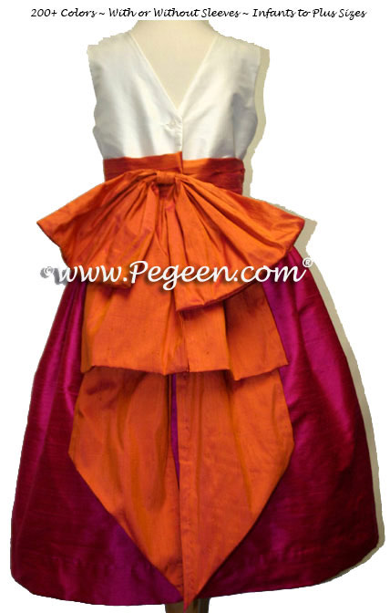 Flower girl dress with V-Back in raspberry pink  and mango orange | Pegeen