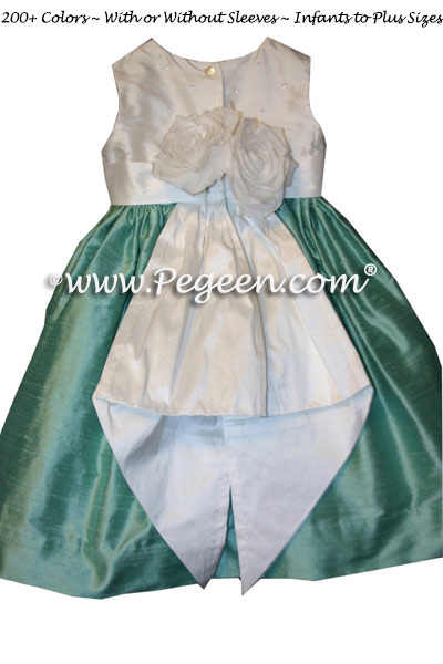 Infant silk dress with sequinned top and tiffany or aqua and white silk by Pegeen