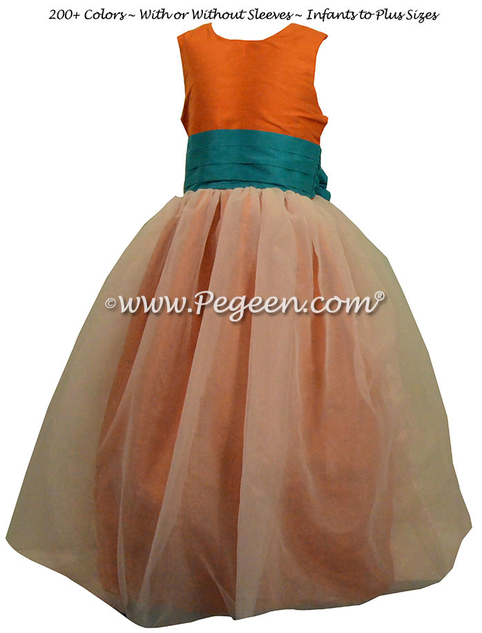 Carrot Orange and Oceanic (teal-blue) flower girl dresses by Pegeen