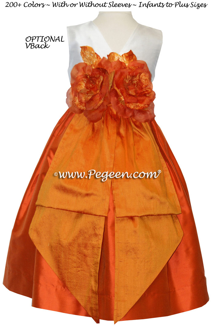 Carrot Orange, New Ivory and Tangerine flower girl dresses by Pegeen