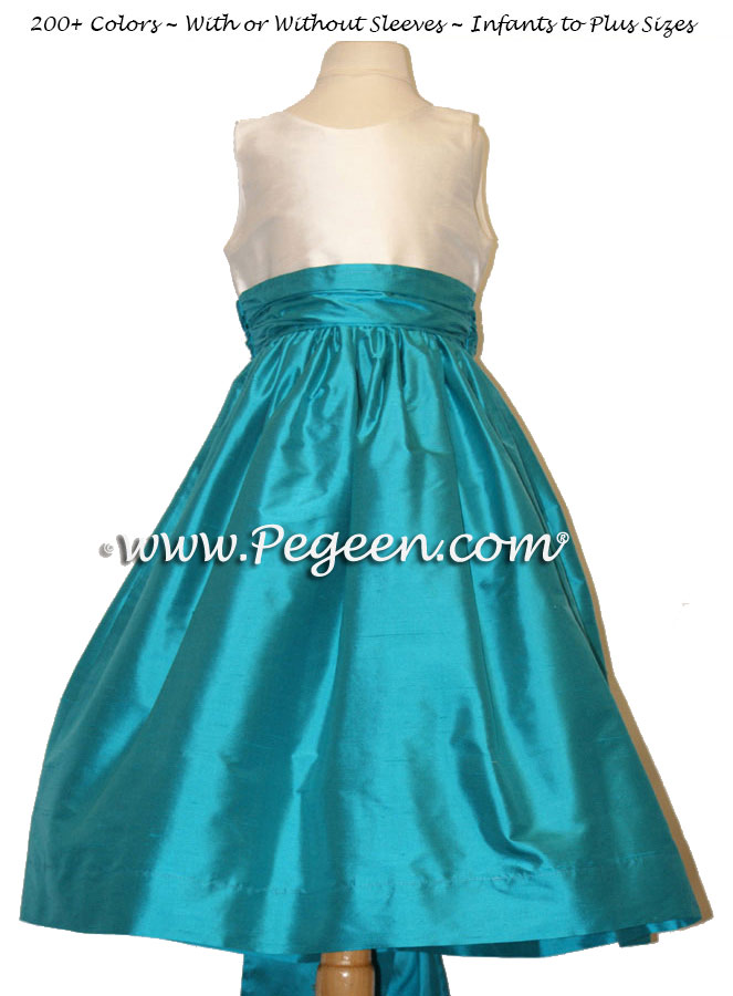Flower girl dresses in silk Ivory and Oceanic (turquoise) | Pegeen