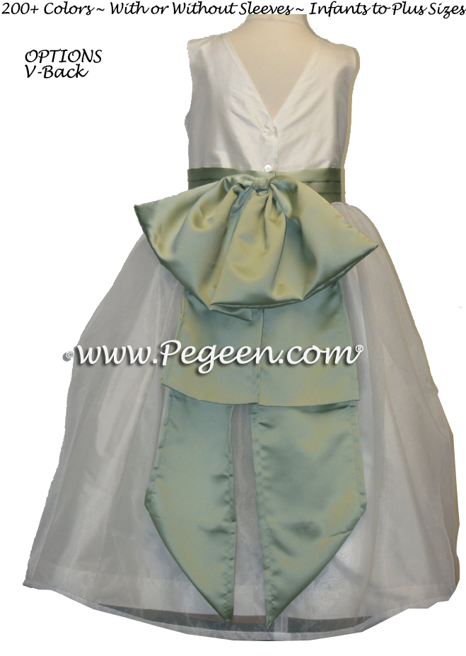 Matching Jim Hjelm flower girl dresses in green and antique white silk