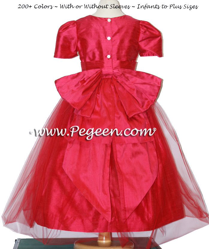 Custom flower girl dress in lipstick pink with Cinderella bow