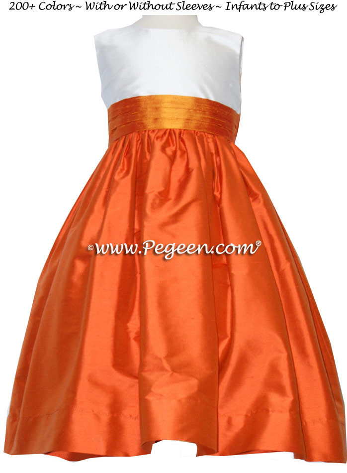 Carrot Orange, Antique White and Tangerine flower girl dresses by Pegeen