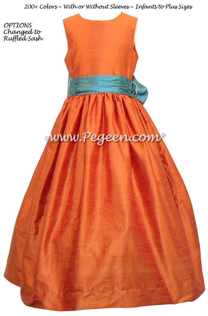 Pumpkin Orange and Blue Juniper flower girl dresses by Pegeen