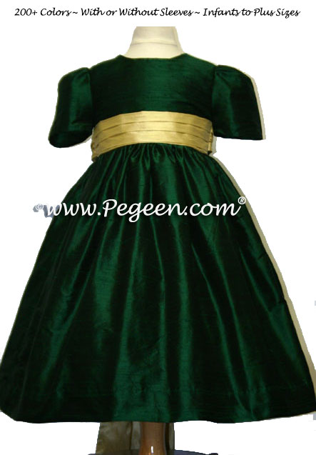Flower girl dresses in shades of green and contrast sash nd spun gold