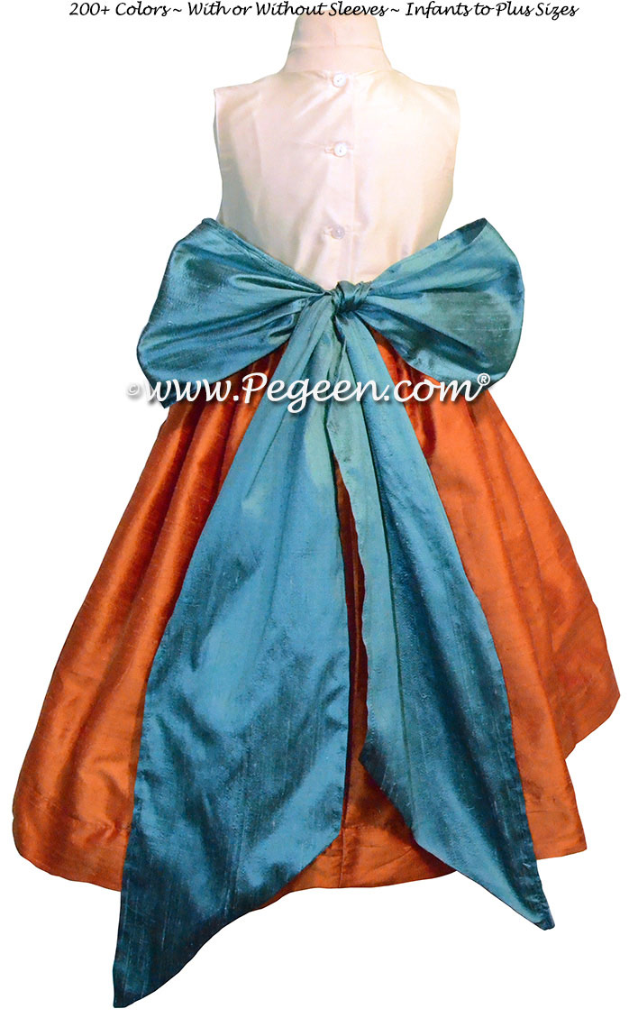 Pumpkin Orange, New ivory and Teal flower girl dresses by Pegeen