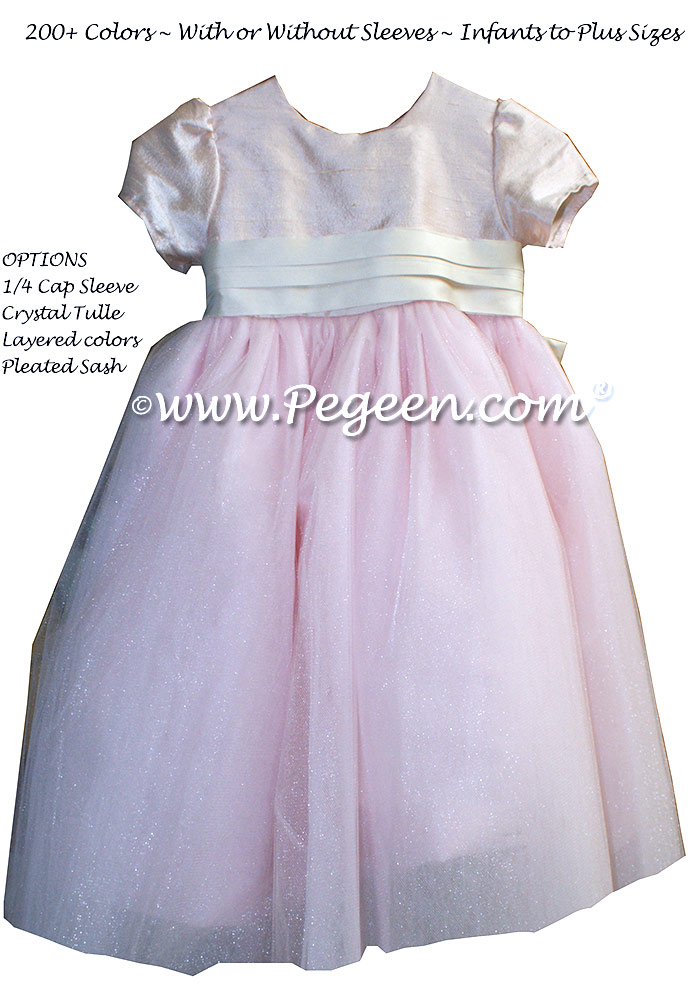 Flower girl Dresses in blush pink with a Special Back Flower