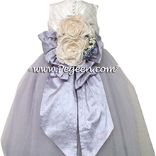 Custom silk couture flower girl dress with light orchid bustle and tulle skirt