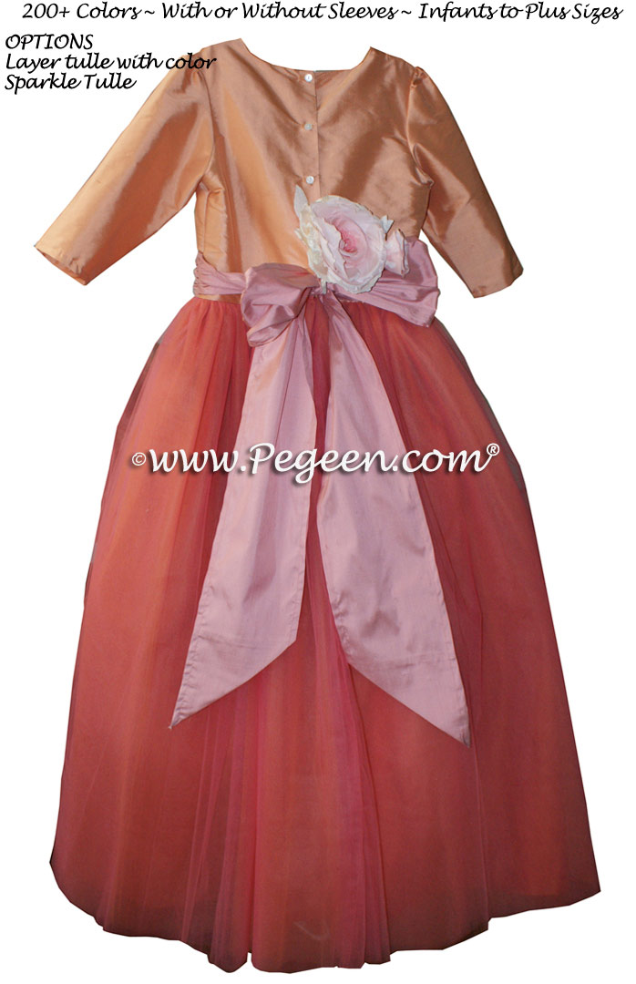 Custom silk tulle flower girl dresses in multiple shades of coral and oranges