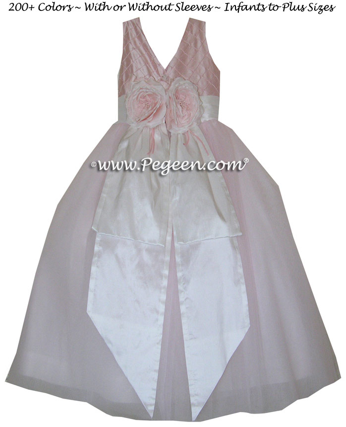 Pintuck and pearls in petal pink Tulle flower girl dress with 10 layers of tulle