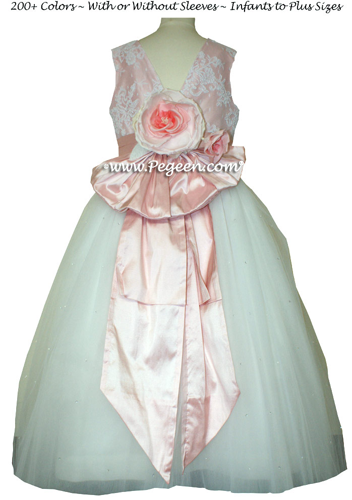 Antique white and peony pink ballerina style flower girl dresses with layersof tulle