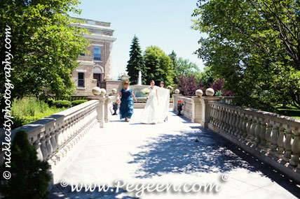 The bride chose Medium Gray and Antique White silk for her flower girl dress in style 398
