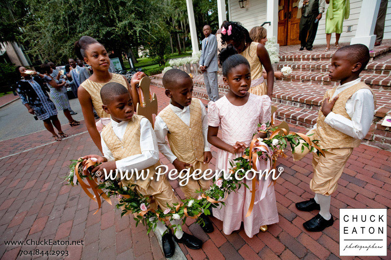 Flower girl dresses and Jr. Bridesmaids dresses and Ring Bearer Suits in Spun Gold and Petal Pink