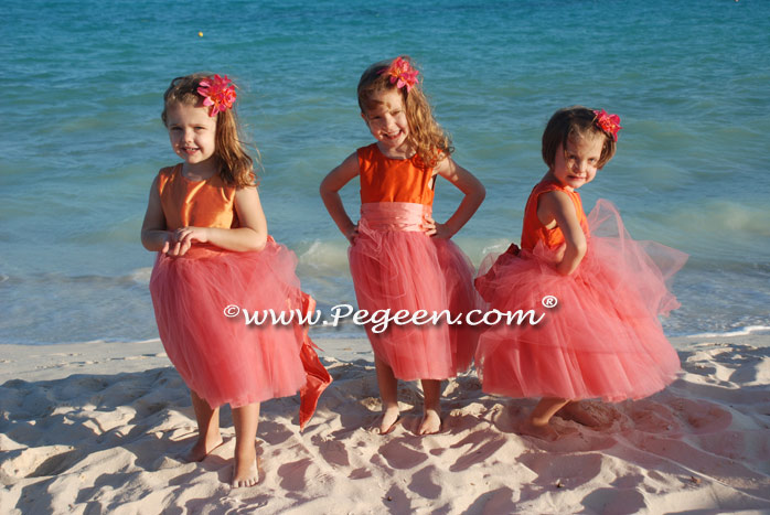 Coral and mango shades for a beach wedding pegeen flower for Flower girl dress for beach wedding