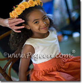 Orange flower girl dresses by Pegeen