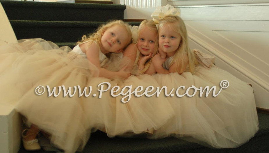 This bride chose various shades of ivory and bisque to accent her flower girls' tulle dresses