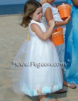 Beach Wedding with aqua tulle and sea shells in skirt
