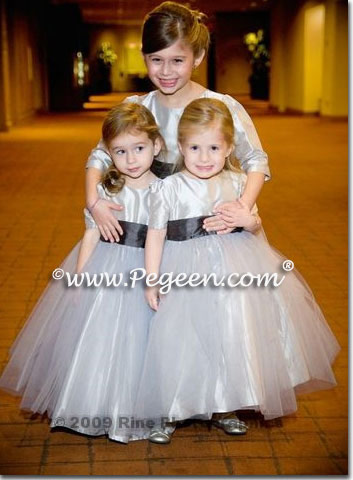 Flower girl dresses and Jr Bridesmaids dresses with long sleeves and high necks  on gray tulle dress