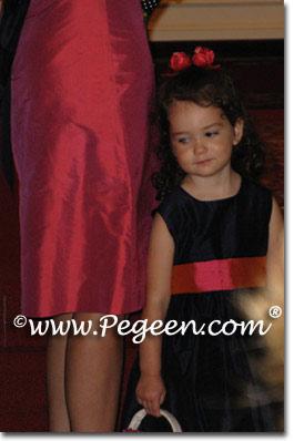 Pink sorbet and black flower girl dresses