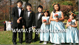 Caribbean blue and platinum flower girl dress to match Jim Hjelm bridesmaids