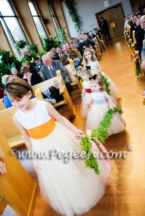 beautiful tulle flower girl dresses in creme, ivory and colors by Pegeen.com