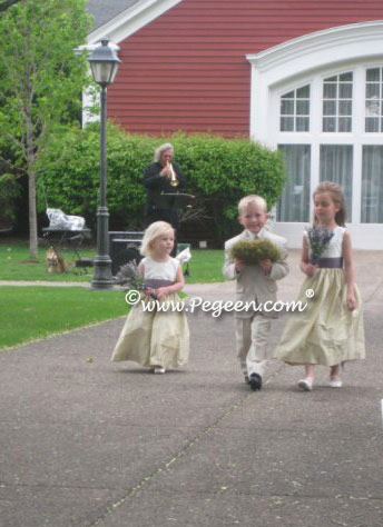 Flower girl dresses with matching doll in spring green and euro lilac.