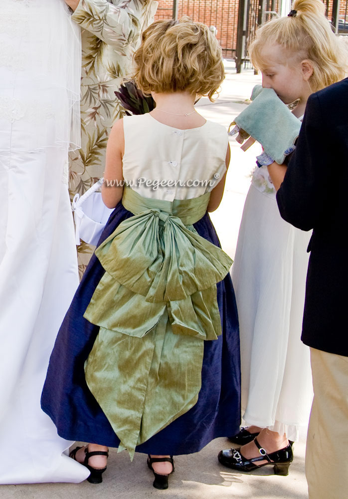 Flower girl dress in navy blue and ivory and a sage green sash