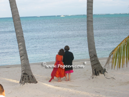 Orange and hot pink flower girl dresses in Belize
