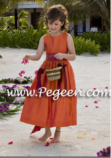 Custom flower girl dress at a beach wedding in squash and sorbet pink