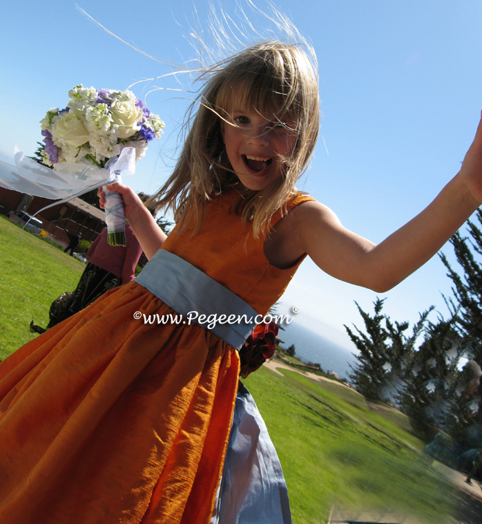 Orange and powder blue flower girl dress