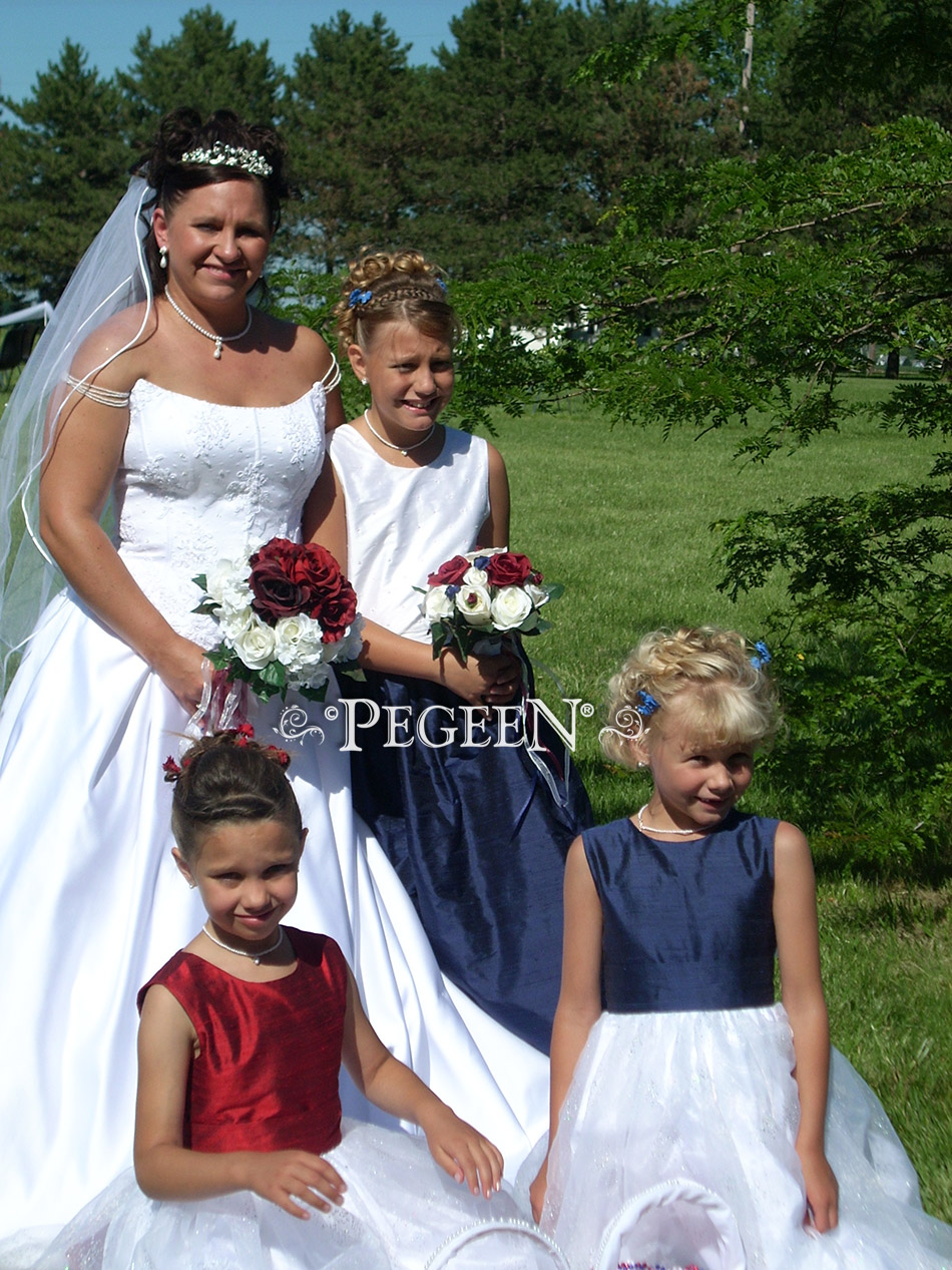 Red flower girl dresses in tulle by Pegeen