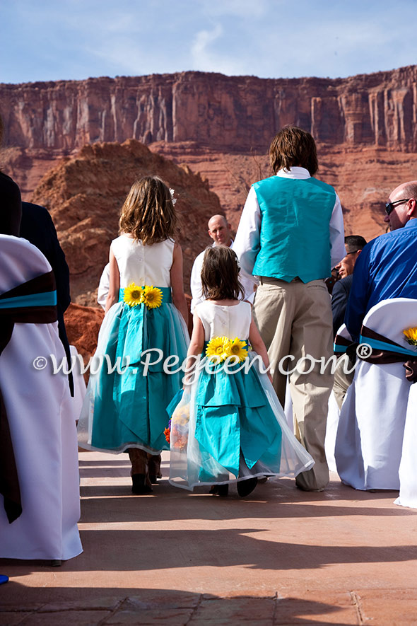 Turquoise and white silk and organza flower girl dresses with matching boy's vest
