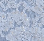 White beaded aloncon - shown on blue fabric