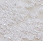 Ivory beaded aloncon - shown on creme fabric