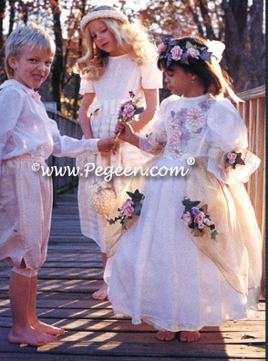 Three styles above, all silk. Boy's Ring Bearer style is in Peach and Antique White - style 286. Girl's flower girl dress rear was made from customer's fabric. Girl, right front in style 609