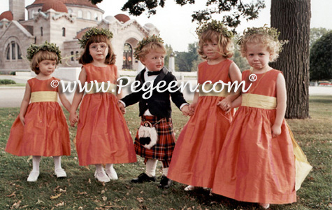Sunflower yellow and mango orange flower girl dresses by Pegeen