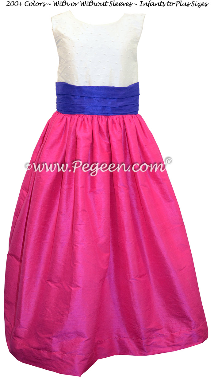 Flower girl dress in hot pink and sapphire blue with a pearl bodice