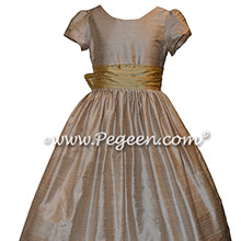 Toffee creme with a spun gold silk sash Style 388