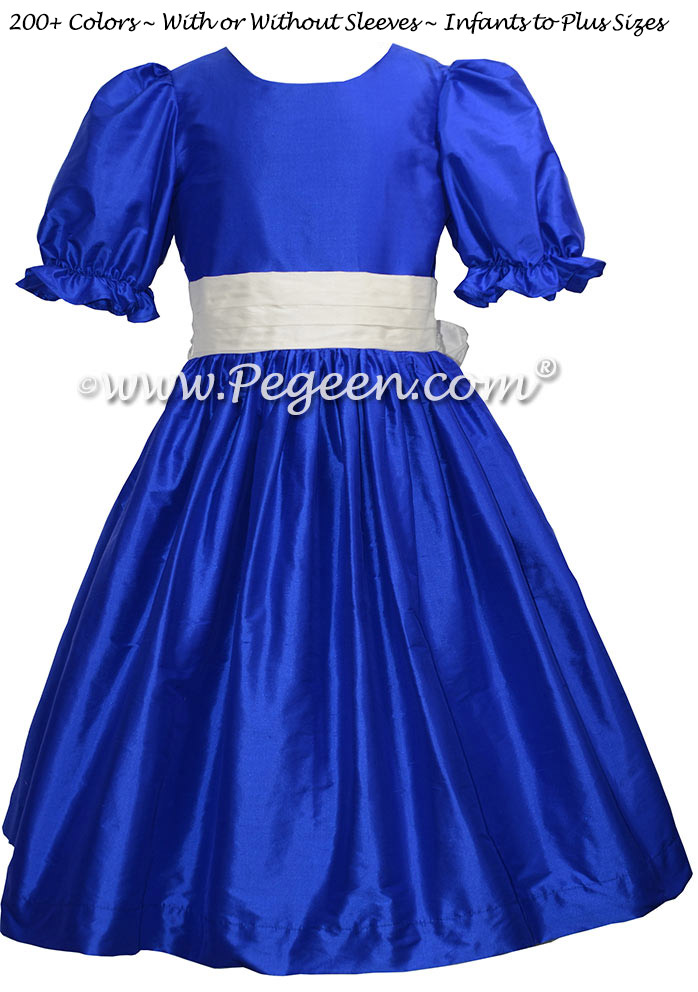 Style 398 flower girl dress in sapphire blue with an antique white silk sash