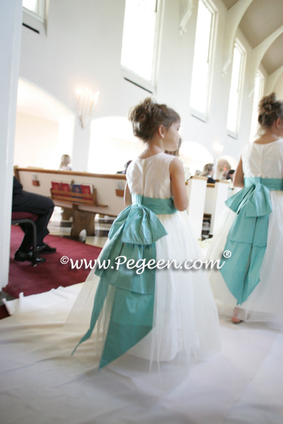3 flower girl dresses in Tiffany Blue parade down aisle