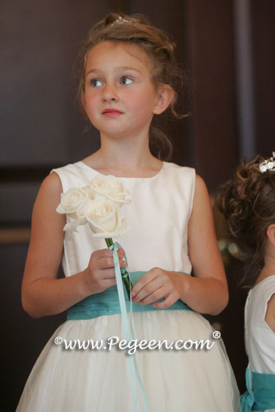 Flower girl dress waits at church