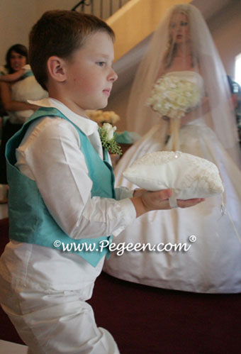 ring bearer boy knicker set goes down the aisle