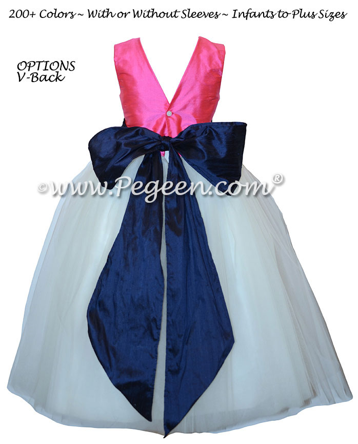 Hot pink flower girl dress with navy silk sash and tulle
