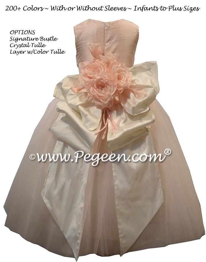 Pink delicate handmade silk flowers on this flower girl dress