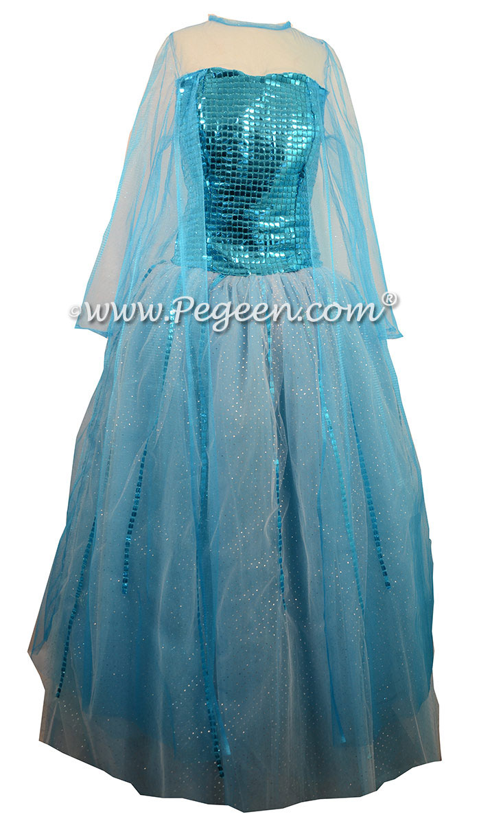 Turquoise Silk and Tulle with a Sequin Bodice, Glitter Mesh Sleeves and Cape with Multi Layered Colors of Tulle.  Silk Style 908 Flower Girl Dresses called Blue Diamond Elsa Dress